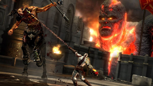 God of War 3 screenshot of Kratos fighting and a Titan in the background