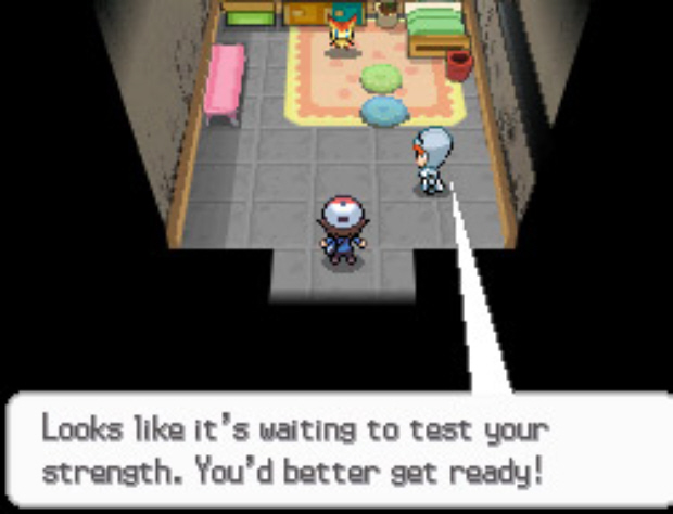 Victini waits to battle at lighthouse basement in Liberty Garden. Pokemon Black and White screenshot